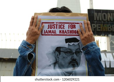 MAKASSAR, INDONESIA - OCTOBER 18 2018: Humanitarian activists hold a poster with a picture of Jamal Khashoggi demonstrating in Makassar. Jamal Khashoggi, a journalist who was killed in Turkey