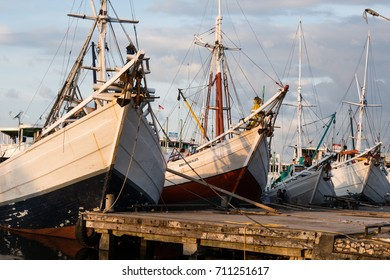 Makassar, Sulawesi, Indonesia - November 17, 2016: Traditional wooden two-masted pinisi sail boats, built by local ethic people of South Sulawesi, at Port Paotere of Makassar.