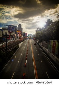 Makati City, Philippines - November 12, 2017: Edsa-Guadalupe Road - Train railway, businesses and beautiful clouds formation is also visible