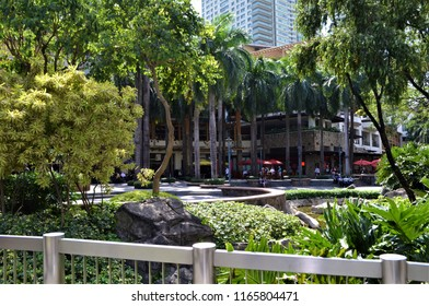 Makati City, Philippines on February 02, 2015.  The financial district of The Philippines with skycraper buildings and green spaces for locals and tourist to enjoy.