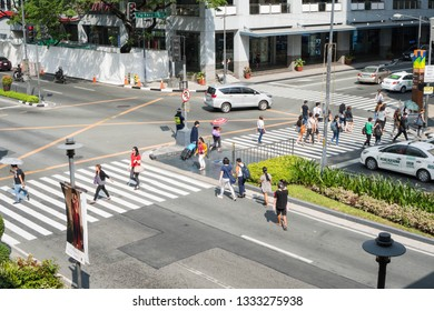 Makati / Philippines - February 22, 2019: a sunny day intersection on Makati Ave and Palm Drive