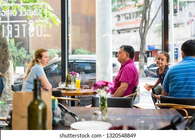 Makati/Philippines - February 5, 2019: two foreigner having date while the man making eye contact and the women is looking outside