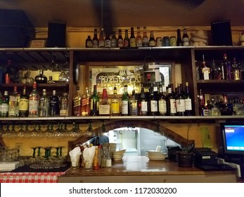 Makawao, Maui - November 5, 2016:  Polli's Mexican Restaurant bar with liquor display and opening to the kitchen.  Quaint Mexican eatery is a busy spot for homestyle quesadillas, fish tacos, ribs.