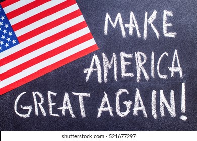 Make America great again  on the chalk board and US flag. Election concept