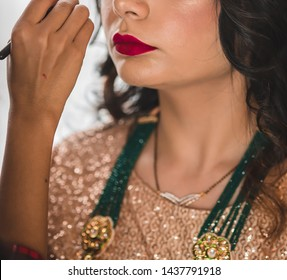 Make up artist applying eye make up on Indian Bride. Karachi - June 30 2019
