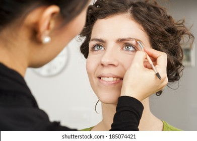 Make up artist hand and her model