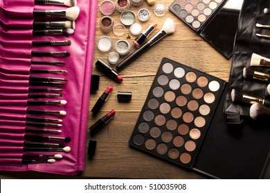 Make up artist theme. Various makeup products. Top view. Set of professional cosmetic: make-up brushes, shadows, lipstick. Place for typography and logo.