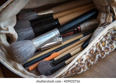 make up bag with cosmetics and brushes