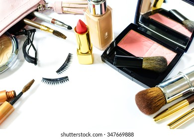 make up bag with cosmetics and brushes isolated on white with copy space
