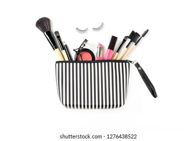 Make up bag with various cosmetics and brushes isolated on white background, Top view, Beauty concept