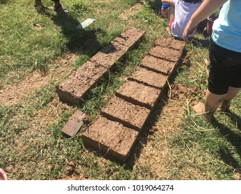 Make bricks from clay, chaff and straw. To build a house made of clay.