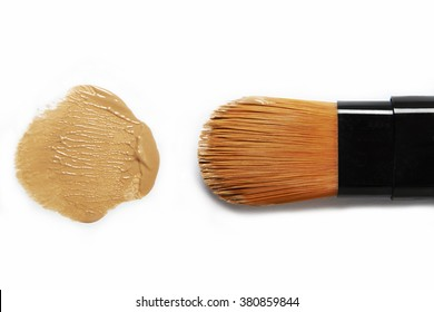 make up brush and foundation spot on white background