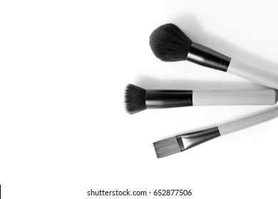 make up brush / A brush is a tool with bristles, wire or other filaments, used for cleaning, grooming hair, make up, painting, surface finishing and for many other purposes.