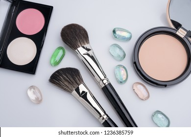 Make up brushes, eyeshadows and powder view