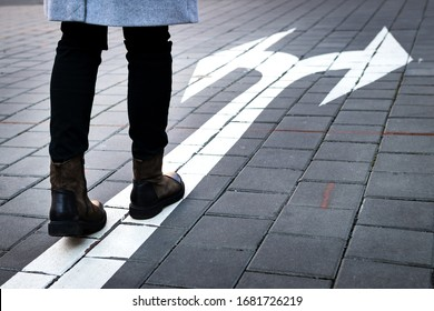 Make choice which way to go. Decision concept with directional arrow sign on road and woman