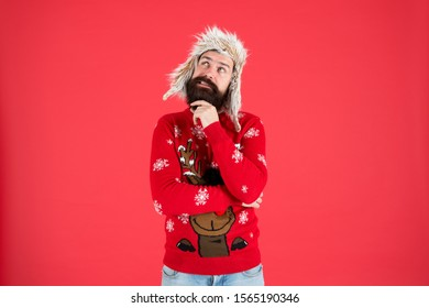 Make christmas wish. Life changing decision. Hipster bearded man wear winter sweater and hat. Happy new year. Winter party outfit. Man thoughtful face expression. Hard decision. Decision making.