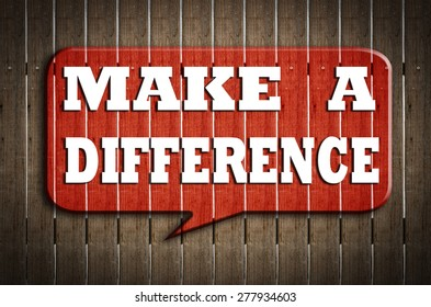 """"""" make a difference"""" on red speech bubble wood on wood background"""
