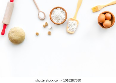 Make dough. Ingedients flour, eggs near cookware on white background top view copy space