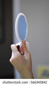 make up with the hand mirror