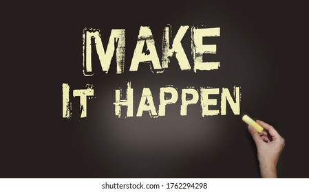 Make It Happen written in chalk on a used blackboard. Used in business, life and sports coaching this well known phrase or saying has become a rallying cry for getting things done.