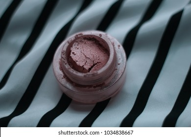 Make up Highlighter Powder on black and white stripes background