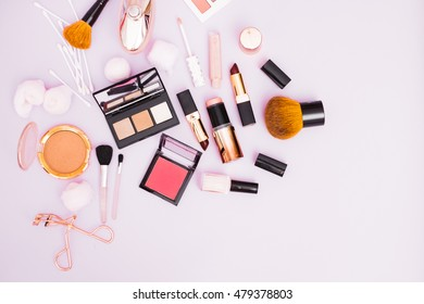 Make Up and Hygiene Items on a Pastel Background