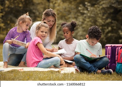 Make kids education fun. Teacher with children in nature. Spring season.