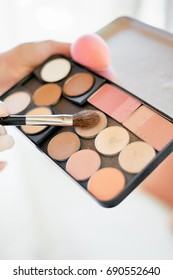 Make up kit holding with brush close up