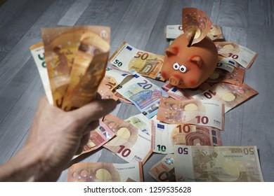 Make lots of money. Hand showing a wad of bills. Piggy bank full of money