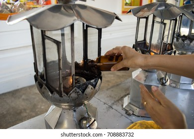 Make merit Fuel oil candle in temple Thailand.