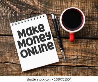 MAKE MONEY ONLINE lettering written on notepad. Business concept.