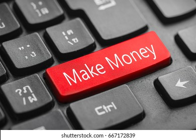 Make money word on red keyboard button over black keyboard