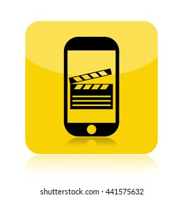 Make movie by a smartphone icon with a clapper board on touch screen isolated on white background