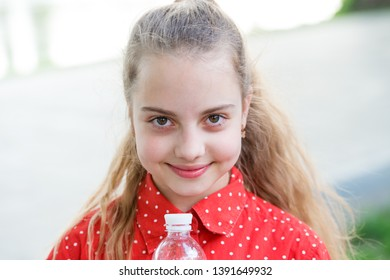 Make one more sip. Live healthy life. Healthy and hydrated. Girl care about health and water balance. Girl cute cheerful hold water bottle. Water balance concept. Drink water during summer walk.