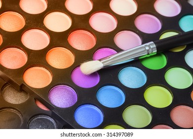 Make up pallet with brush .