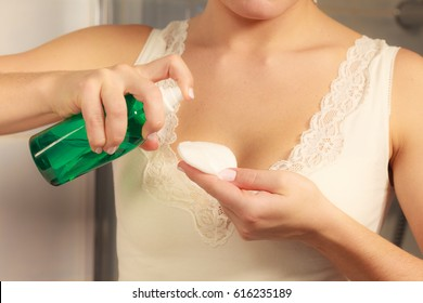Make up remove skin care. Closeup woman holding cotton swab and makeup remover liquid cosmetic in hands.