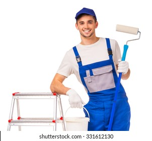 To make repairs. A young man in working clothes painting the walls in the room