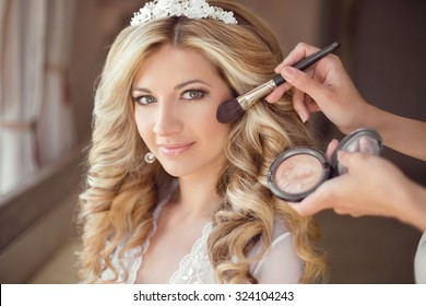 make up rouge. Healthy hair. beautiful smiling bride wedding portrait. Stylish makes makeup Young woman with long curly hair style.
