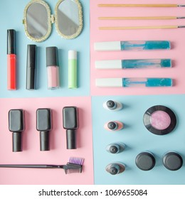 Make up set on pastel background top view. Manicure fashion modern bright background. Trendy minimal pop art style and pastel colors