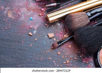 make up set, soft  makeup  brushes and  maskara on black background