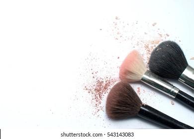 Make up set, soft makeup brushes and maskara on whight background