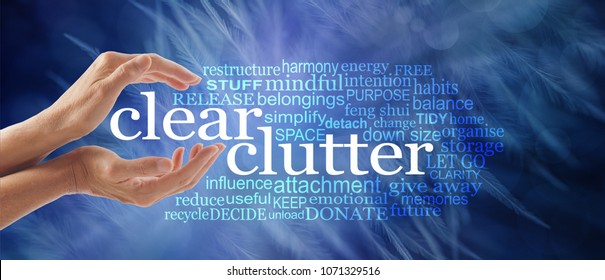 Make space in your life and clear your clutter - female cupped hands around the words CLEAR CLUTTER surrounded by a relevant tag word cloud on a dark ethereal wispy feather background