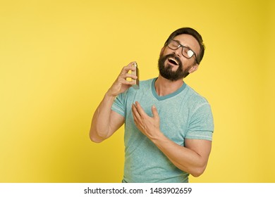 Make sure smell fresh throughout day. Wearing perfume is enhancing mood. Amazing benefits of using perfumes. Man bearded handsome hold bottle perfume. How choose perfume for men according to occasion.
