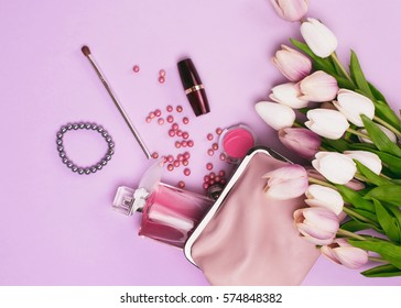 Make up table with pink accents and flowers on pink background