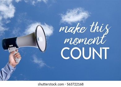 Make this Moment Count. Hand with megaphone / loudspeaker. Business concept.
