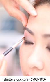 Make up. Eye-shadows with Eye shadow brush.