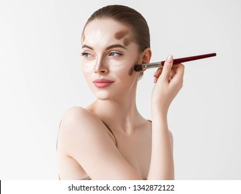 Make up woman face. closeup Contour and Highlight makeup sample. Professional Contouring face make-up over white background