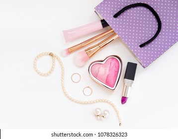 Make up for young women cosmetic product in gift bag. Top view