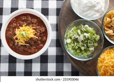 A make your own chili bar with toppings. This is perfect for any football tailgating or home entertaining event.
