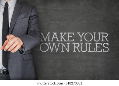 Make your own rules on blackboard with businessman